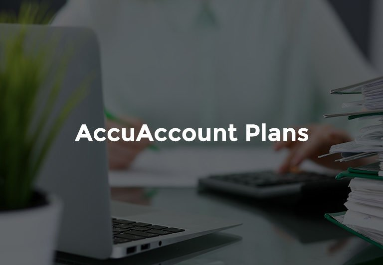 """Hand typing on calculator in front of laptop with text, """"AccuAccount plans"""""""