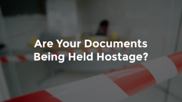 """Warning tape sectioning off police scene with text, """"Are your documents being held hostage"""""""