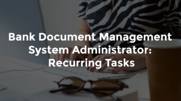 """Banker typing on desk with text, """"Bank Document Management System Administrator - Recurring Tasks"""""""