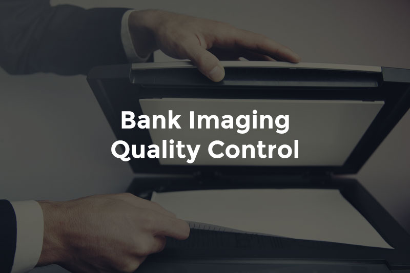 """Male banker's hands closing scanner over paperwork and text, """"Bank imaging quality control"""""""