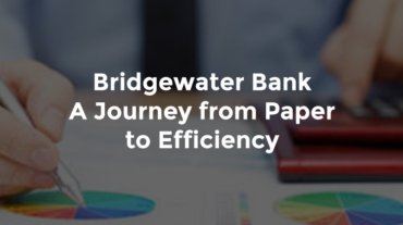 """Hand writing notes on banking report with graphs and text, """"Bridgewater Bank - a journey from paper to efficiency"""""""