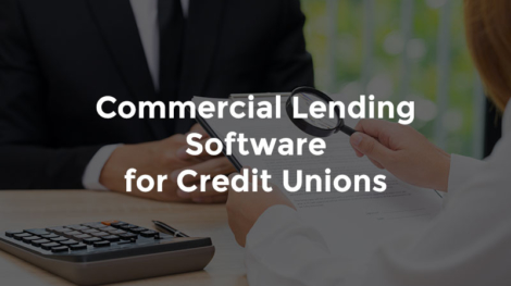 """Banker and customer seated at a desk with text, """"Commercial lending software for credit unions"""""""