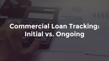 Hand with calculator on top of banking reports with text: Commercial loan tracking initial vs. ongoing