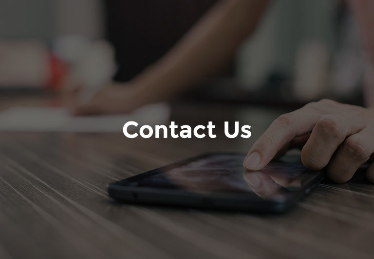 """Banker using smartphone with text, """"Contact us"""""""