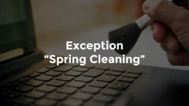 "Hand with soft brush cleaning computer keyboard with text, ""Exception spring cleaning"""