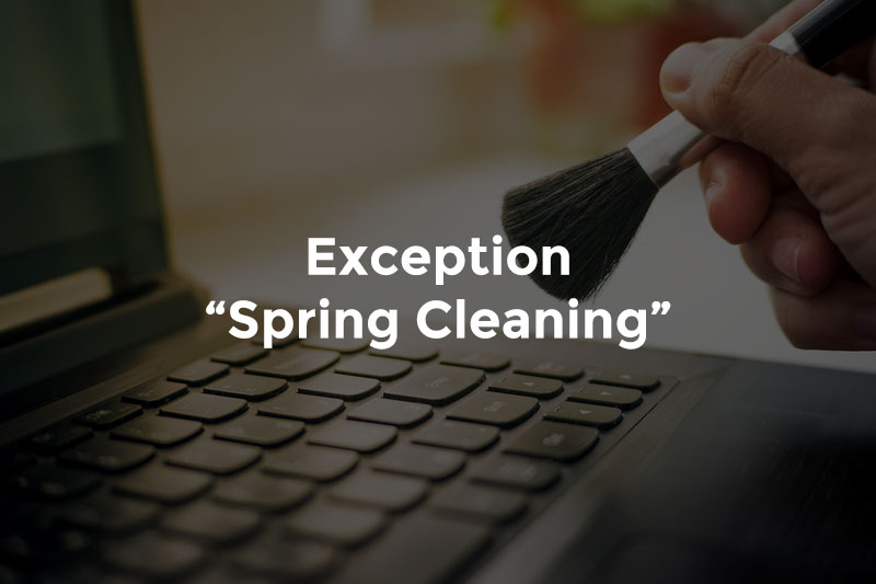 """Hand with soft brush cleaning computer keyboard with text, """"Exception spring cleaning"""""""