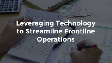 """Hand writing on paper atop more notes and paperwork with text, """"Leveraging technology to streamline frontline operations"""""""