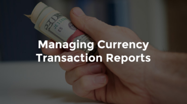 """Hand holding roll of 20-dolla bills with text, """"Managing currency transaction reports"""""""
