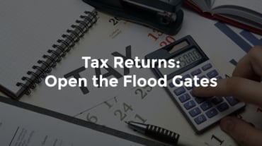 """Paper notes for taxes with calculator and pen, with text, """"Tax returns - open the flood gates"""""""