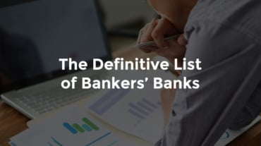 "Male banker looking over graphs on desk with text, ""The definitive list of bankers' banks"""