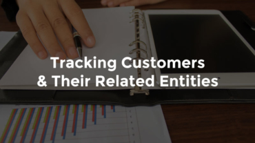 "Hands writing on paper in a binder with bank reports laid out and text, ""Tracking customers and their related entities"""