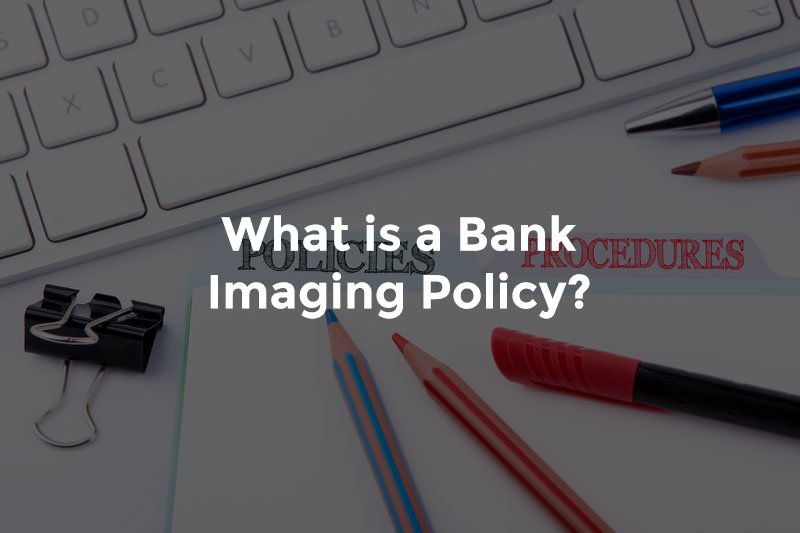 Pencils and pens over a banker's desk with text What is a bank imaging policy
